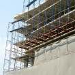 Facade  and building with construction site — Stock Photo #43749095
