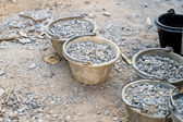 Raw material for construction, stone and pail — Stock Photo