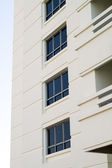 Rows of many white balconies of a modern building — Stock Photo