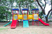 Playground without children in a park — Stock Photo
