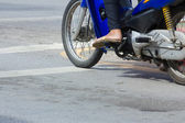 Motorcycle stop at white line on junction waiting for traffic li — Stock Photo