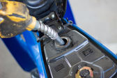 Refueling a motorcycle at a gas station in thailand — Stock Photo