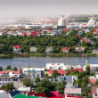 Bird s eye view of houses of Reykjavik against smoky clouds background — Stock Photo