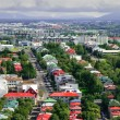 Bird s eye view of houses of Reykjavik on smoky clouds background — Stock Photo