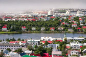 Bird s eye view of houses of Reykjavik against smoky clouds background — Foto Stock