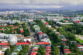 Bird s eye view of houses of Reykjavik on smoky clouds background — Stockfoto