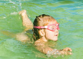 Little swimming girl with swimming glasses — Stock Photo