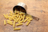 Pasta in measuring cup — Stock Photo