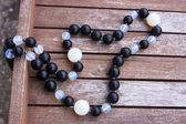 Necklace of black and moonstone beads — Stock Photo