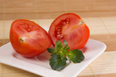 Two sliced tomates on a white plate — Stock Photo