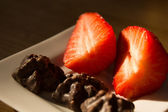 Two strawberries or three pieces of chocolate — Stock Photo