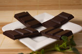 Four dark chocolate bars — Photo