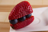 Strawberry sandwich with huckleberries — Stock Photo