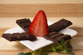 Strawberry and chocolate bars like a star — Stock Photo