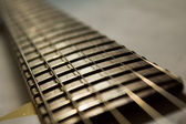 Brown rosewood neck of a guitar — Stock Photo