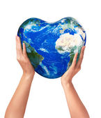 3d heart earth in the hands — Stock Photo