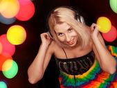 Woman dj in headphones — Stock Photo