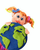 Plasticine girl with earth — Стоковое фото