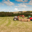 Tractor at Straw harvesting — Stock Photo