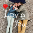 Love story under the painted rain. Man and woman in love. The girl is in love with his friend. — Stock Photo