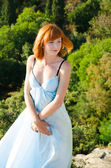 Red-haired girl in a blue dress — Stock Photo
