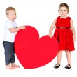 Children with huge heart made of red paper — Stock Photo #41350939