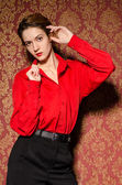 Girl in red male shirt. In retro interior — Foto de Stock