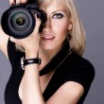 Elegant sexy girl holding a camera — Stock Photo #41413117