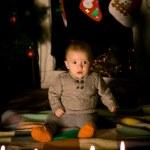 Baby sitting on  floor near fireplace — Stock Photo #41413397