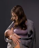 woman holding arms of newborn baby — Foto Stock