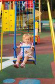 Little blonde girl walking in park — Stock Photo