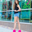 Young woman in shorts and pink shoes — Stock Photo #51418163