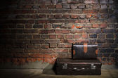 Retro bags on brick wall background — Stock Photo
