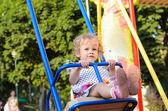 Girl riding on Swings — Stock Photo