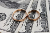 Wedding rings on the background of money — Stock Photo
