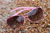 Rose colored glasses on the beach — Foto de Stock