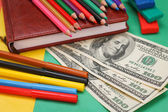 Pens, colored pencils, plasticine, book, hundred dollar bills — Stock Photo