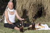 Old rural man using scythe — Stock Photo