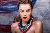 Beautiful girl with big beads — Stock Photo