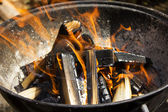 Hot burning wood charcoal, grill on fire — Stock Photo