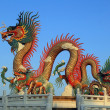 Golden dragon on beautiful sky background — Stock Photo