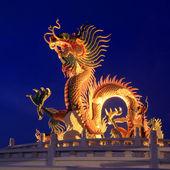 Golden dragon on beautiful sky background — Stock Photo