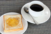Pineapple jam on bread and coffee — Stockfoto