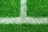 White stripe on green soccer field — Stock Photo