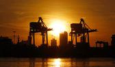 Port warehouse with container cargo and crane bridge — Stock Photo