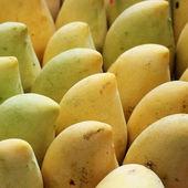 Sweet mango at fruit market — Stock Photo