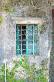 Metal window frame on a old house — Stock fotografie