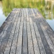 Wooden Bridge to the lake — Stock Photo