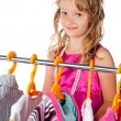 Stock Photo: Cute little girl who loves clothes