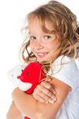Beautiful young girl hugging a toy — Stock Photo